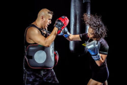 """<img src=""""woman punching pads.jpg"""" alt=""""how to train on a heavy bag""""/>"""