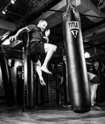 "<img src=""man kicking punch bag.jpg"" alt=""what is in a punching bag""/>"