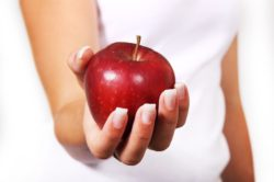 "<img src=""hand holding red apple.jpg"" alt=""how many calories should i eat in a day""/>"