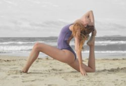 "<img src=""woman stretching on beach.jpg"" alt=""how many days a week should you stretch""/>"