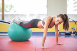 "<img src = ""woman doing ball assisted press ups.img"" alt = ""best strength training workouts""/>"