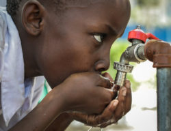 """<img src=""""third world child drinking water.jpg"""" alt=""""what is the importance of drinking water""""/>"""