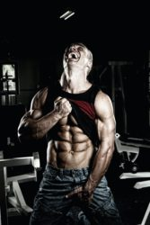 """<img src="""" man showing his muscles.jpg"""" alt=""""Best stomach exercise""""/>"""