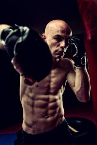 "<img src=""man training on a punching bag.jpg"" alt=""how to train on a heavy bag""/>"